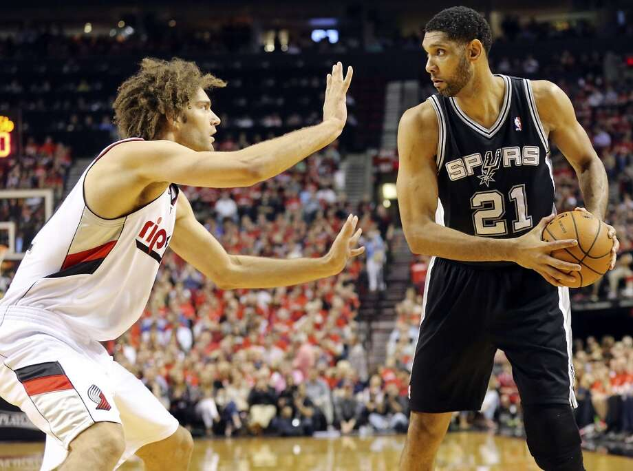 San Antonio Spurs' Tim Duncan looks for room around Portland Trail Blazers' Robin Lopez during first half action of Game 4 in the Western Conference semifinals Monday May 12, 2014 at the Moda Center in Portland, OR. Photo: Edward A. Ornelas, San Antonio Express-News