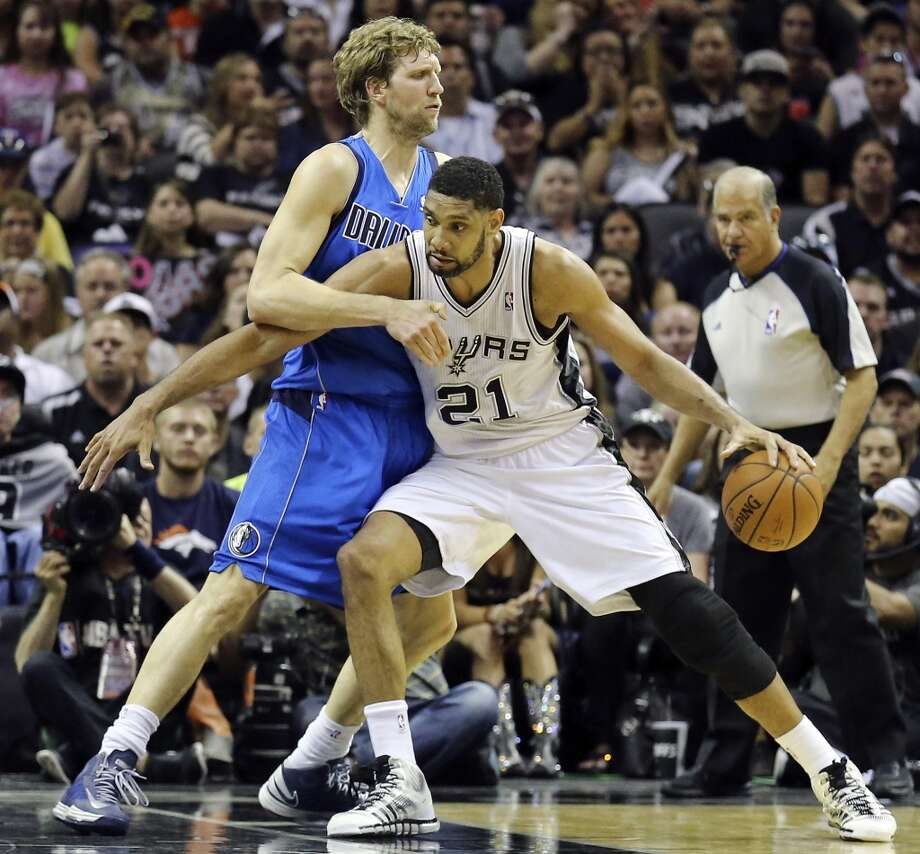San Antonio Spurs' Tim Duncan looks for room around Dallas Mavericks' Dirk Nowitzki during first half action of Game 7 in the first  round of the Western Conference playoffs  Sunday May 4, 2014 at the AT&T Center. Photo: Edward A. Ornelas, San Antonio Express-News