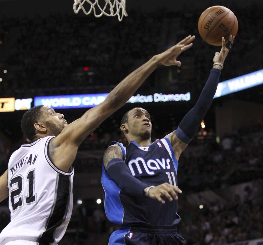 Spurs' Tim Duncan (21) attempts to block a layup by Dallas Mavericks' Monta Ellis (11) in the first half of Game 5 of the first round of the Western Conference playoffs at the AT&T Center on Wednesday, Apr. 30, 2014. (Kin Man Hui/San Antonio Express-News) Photo: Kin Man Hui, San Antonio Express-News