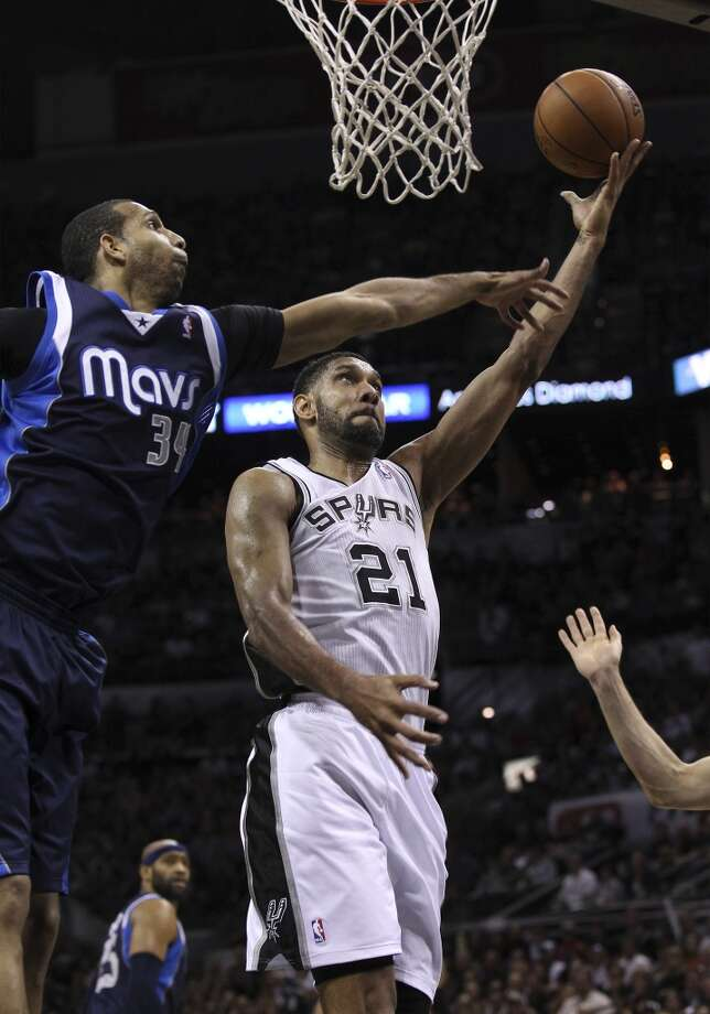 Spurs' Tim Duncan (21) goes the basket against Dallas Mavericks' Brandan Wright (34) in the second half of Game 5 of the first round of the Western Conference playoffs at the AT&T Center on Wednesday, Apr. 30, 2014. Spurs defeated the Mavericks, 109-103. (Kin Man Hui/San Antonio Express-News) Photo: Kin Man Hui, San Antonio Express-News