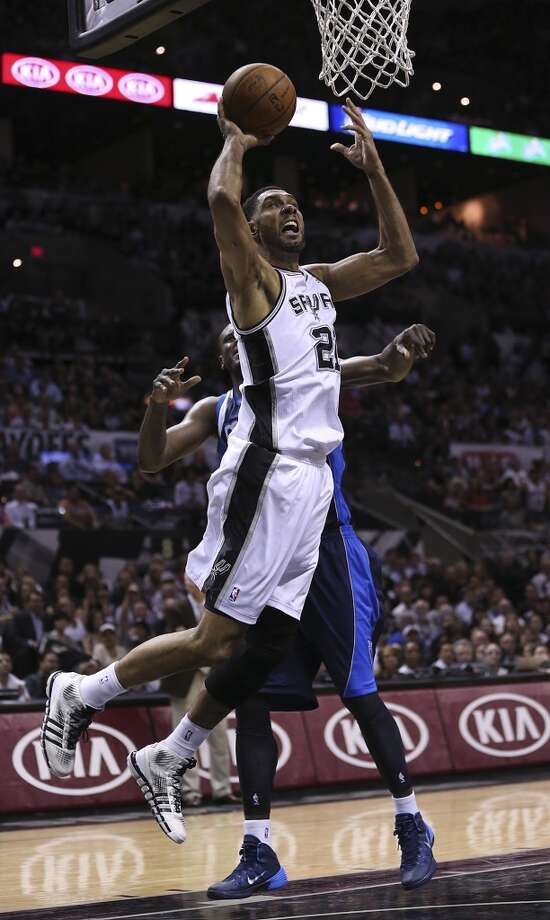 San Antonio Spurs' Tim Duncan goes for the net as Dallas Mavericks' Samuel Dalembert defends during the first half of game five in the first round of the Western Conference Playoffs at the AT&T Center, Wednesday, April 30, 2014. Photo: Jerry Lara, San Antonio Express-News