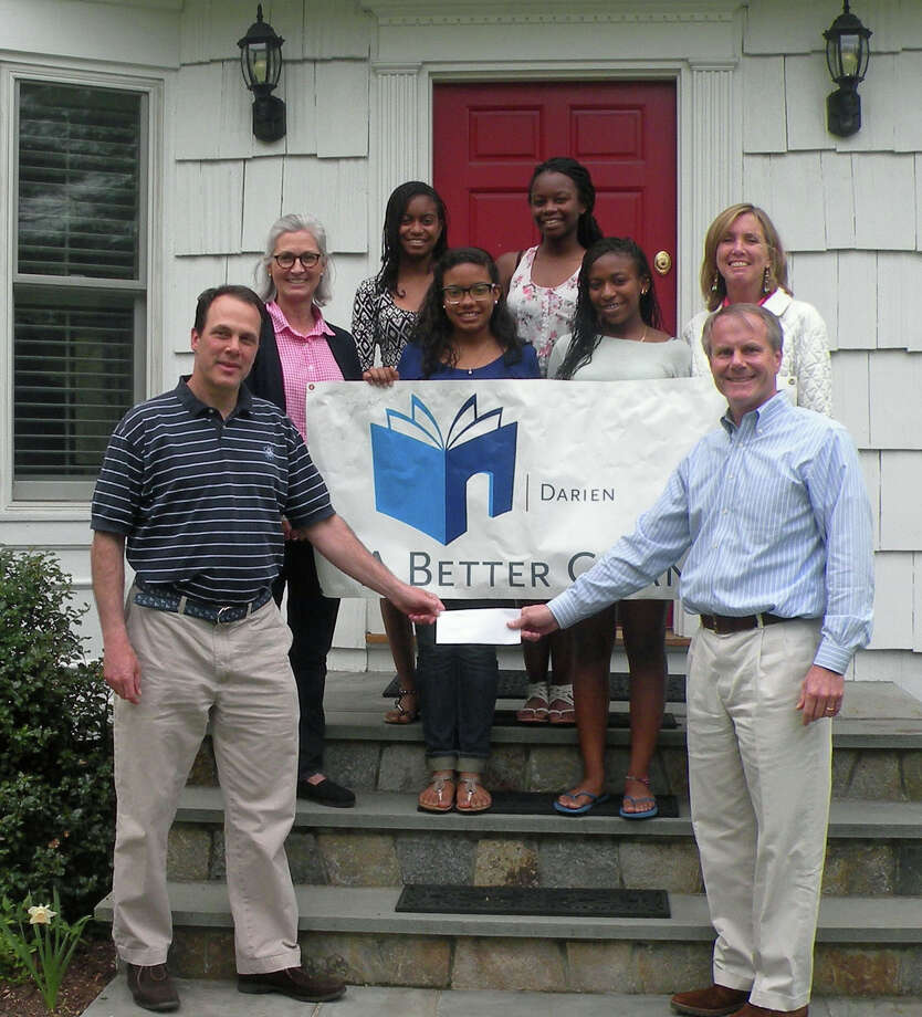 The Darien Foundation for Community and Technology contributed $100,000 to A Better Chance in Darien's capital campaign. From left, Ward Glassmeyer and Pam Dysenchuk of the foundation; ABC Scholars Niamani Williams-Coles, Merlyn Tejada, Mahoghany Dolberry and Danielle McIntosh; and Jackie Scott and Bob Johnston of the ABC board. Photo: Contributed Photo, Contributed / Darien News Contributed