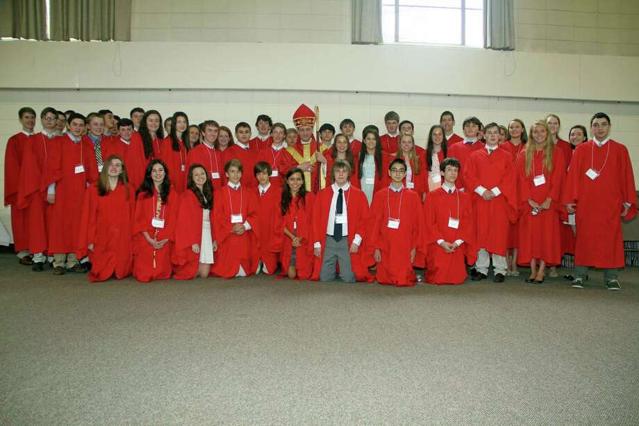 St. Thomas More Catholic Church in Darien recently confirmed 95 members in a ceremony officiated by the Most Rev. Frank J. Caggiano, Bishop of Bridgeport. Photo: Contributed Photo, Contributed / Darien News Contributed