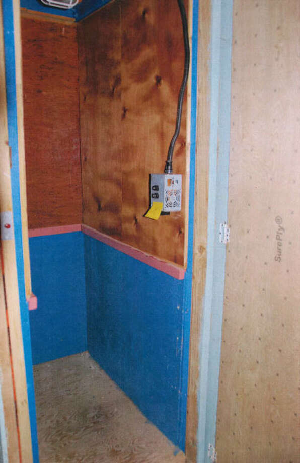 A secret elevator to Kenneth Smith's marijuana grow and child porn computer, pictured in a Justice Department photo. Photo: Department Of Justice