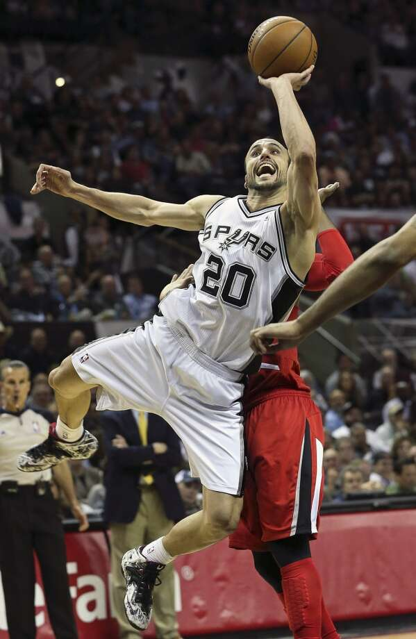 Manu Ginobili cranks up an off balance shot in the lane as the Spurs play Portland in game 5 of the NBA Western Conference semifinals at the AT&T Center  on May 14, 2014. Photo: Tom Reel, San Antonio Express-News