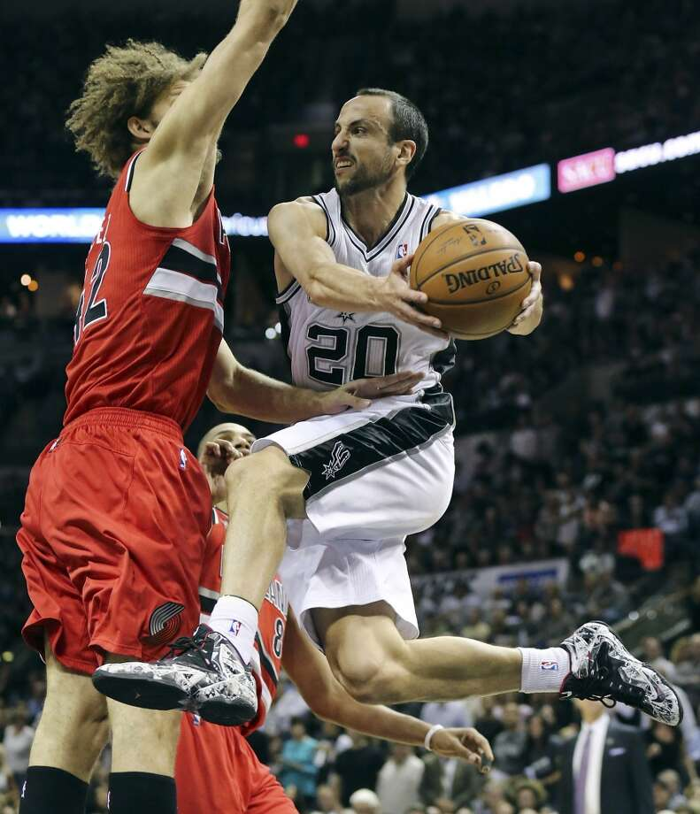 San Antonio Spurs' Manu Ginobili looks to pass around Portland Trail Blazers' Robin Lopez during first half action of Game 5 in the Western Conference semifinals Wednesday May 14, 2014 at the AT&T Center. Photo: Edward A. Ornelas, San Antonio Express-News