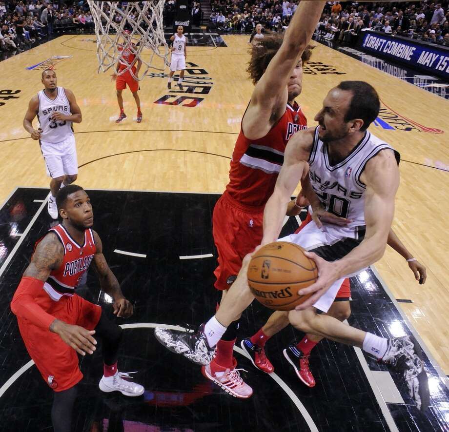San Antonio Spurs' Manu Ginobili looks to pass around Portland Trail Blazers' Robin Lopez and Thomas Robinson during first half action of Game 5 in the Western Conference semifinals Wednesday May 14, 2014 at the AT&T Center. Photo: Edward A. Ornelas, San Antonio Express-News