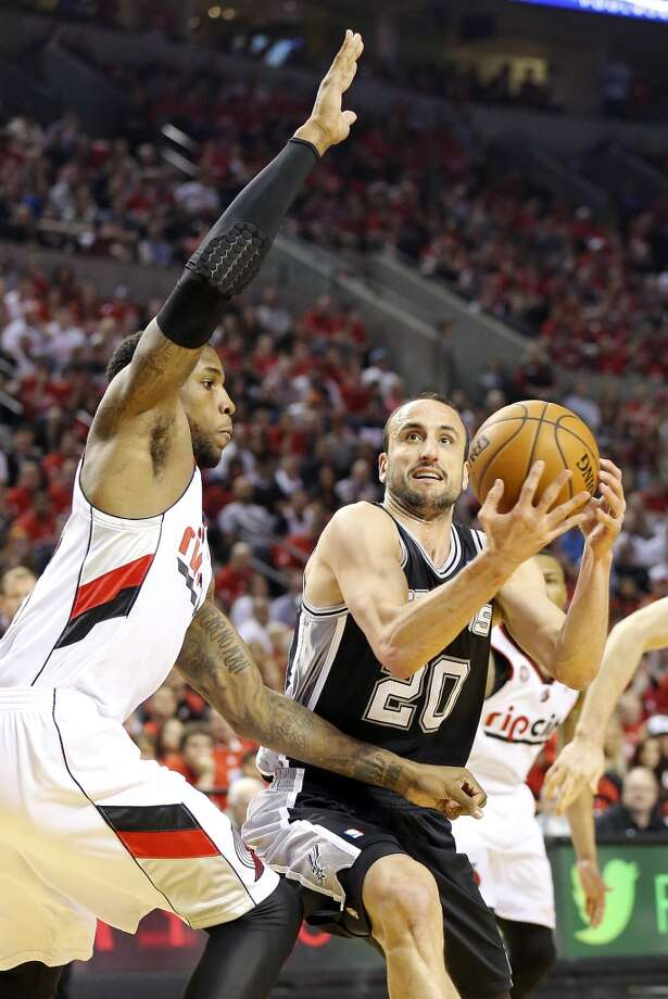 San Antonio Spurs' Manu Ginobili looks for room around Portland Trail Blazers' Thomas Robinson during first half action of Game 4 in the Western Conference semifinals Monday May 12, 2014 at the Moda Center in Portland, OR. Photo: Edward A. Ornelas, San Antonio Express-News