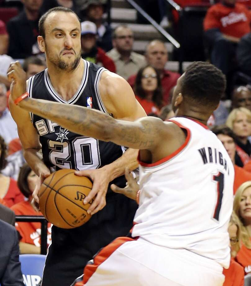 San Antonio Spurs' Manu Ginobili looks for room around Portland Trail Blazers' Dorell Wright during first half action of Game 3 in the Western Conference semifinals Saturday May 10, 2014 at the Moda Center in Portland, OR. Photo: Edward A. Ornelas, San Antonio Express-News