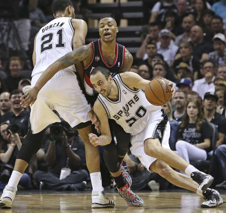 Manu Ginobili uses a screen by Tim Duncan to get away from  Damian Lillard as the San Antonio Spurs play the Portland Trailblazers in game 2 of the Western Conference Semifinals at the AT&T Center on May 8, 2014. Photo: TOM REEL, San Antonio Express-News