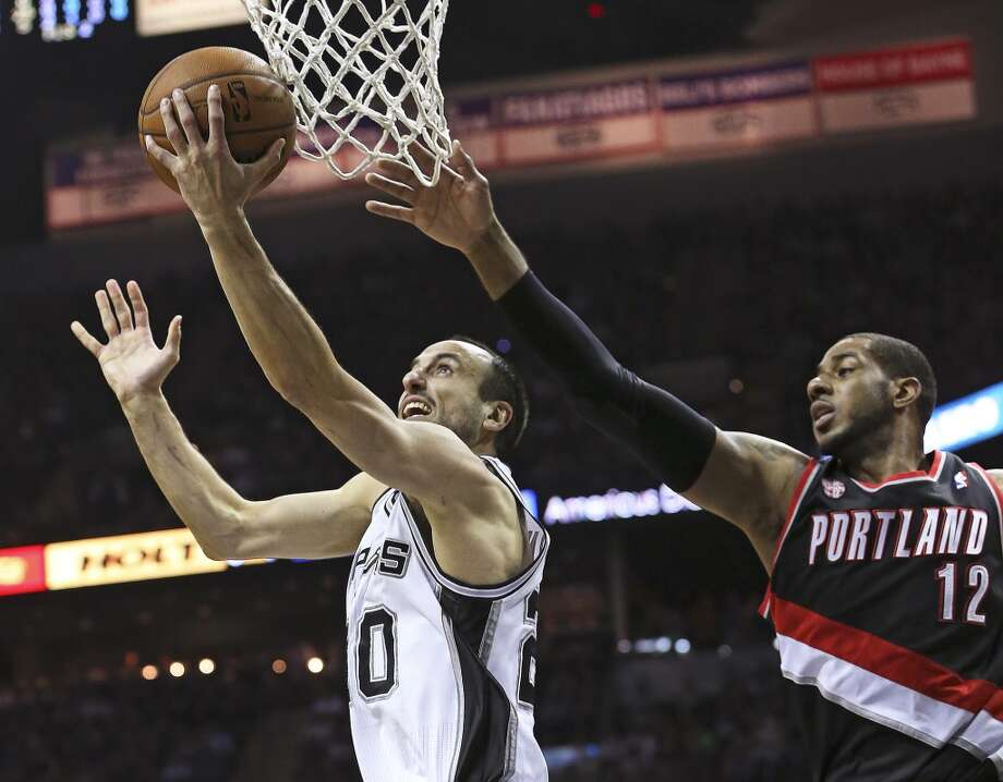 Manu Ginobili beats LaMarcus Aldridge to the hoop as the San Antonio Spurs play the Portland Trailblazers in game 2 of the Western Conference Semifinals at the AT&T Center on May 8, 2014. Photo: TOM REEL, San Antonio Express-News