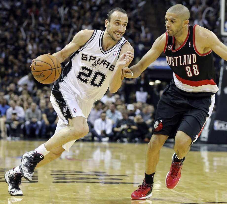 San Antonio Spurs' Manu Ginobili looks for room around Portland Trail Blazers' Nicolas Batum during second half action of Game 2 in the Western Conference semifinals Thursday May 8, 2014 at the AT&T Center. The Spurs won 114-97. Photo: Edward A. Ornelas, San Antonio Express-News