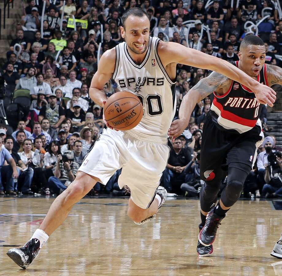 San Antonio Spurs' Manu Ginobili looks for room around Portland Trail Blazers' Damian Lillard during second half action of Game 1 in the Western Conference semifinals Tuesday May 6, 2014 at the AT&T Center. The Spurs won 116-92. Photo: Edward A. Ornelas, San Antonio Express-News