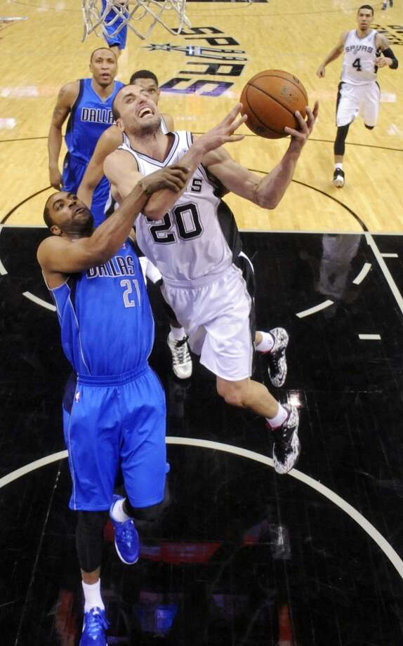 Dallas Mavericks' Wayne Ellington fouls San Antonio Spurs' Manu Ginobili during second half action of Game 7 in the first  round of the Western Conference playoffs  Sunday May 4, 2014 at the AT&T Center. The Spurs won 119-96. The Spurs advance to face Portland in the Western Conference semifinals. Photo: Edward A. Ornelas, San Antonio Express-News