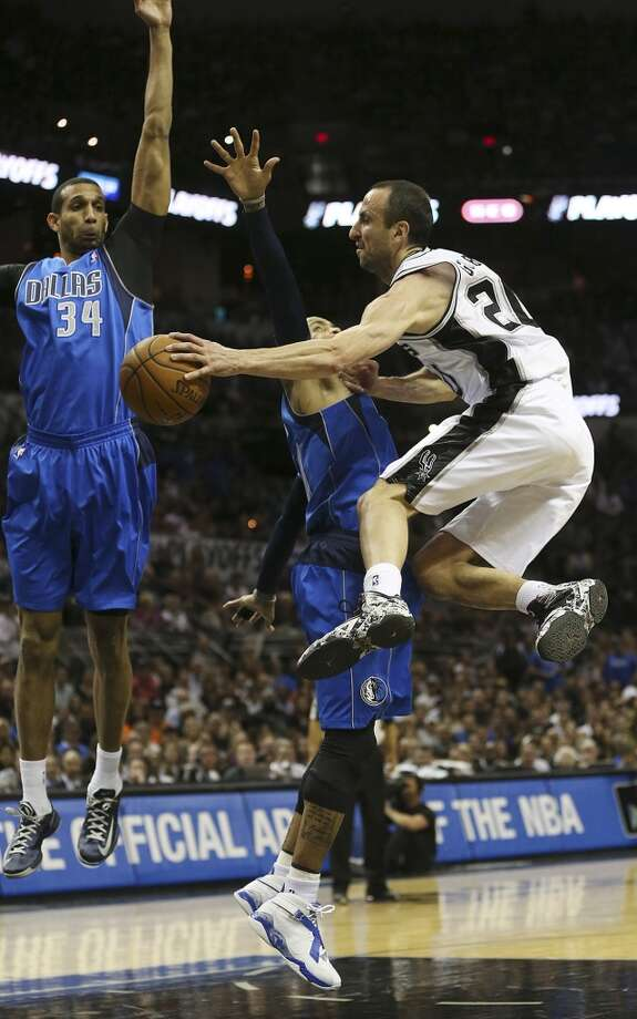 San Antonio Spurs' Manu Ginobili passes around Dallas Mavericks' Monta Ellis as Brandan Wright defends during the first half of game seven in the first round of the Western Conference Playoffs at the AT&T Center, Sunday, May 4, 2014. Photo: Jerry Lara, San Antonio Express-News