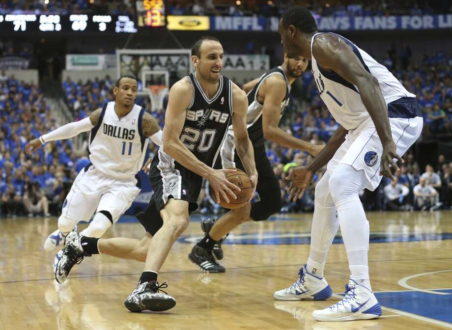 San Antonio Spurs' Manu Ginobili drives between Dallas Mavericks' Monta Ellis, left, and Samuel Dalembert during the second half of game six in the first round of the Western Conference Playoffs at the American Airlines Center in Dallas, Friday, May 2, 2014. The Mavericks won 113-111 to even the series at 3-3. Photo: Jerry Lara, San Antonio Express-News