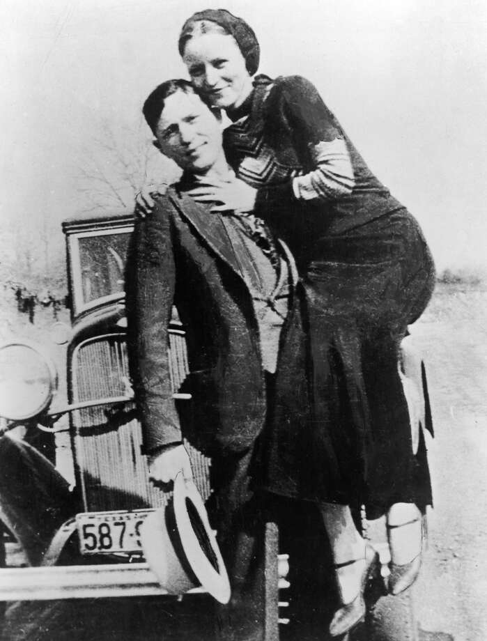 Clyde Barrow holds Bonnie Parker, circa 1933. Photo: Hulton Archive, Getty Images / Archive Photos
