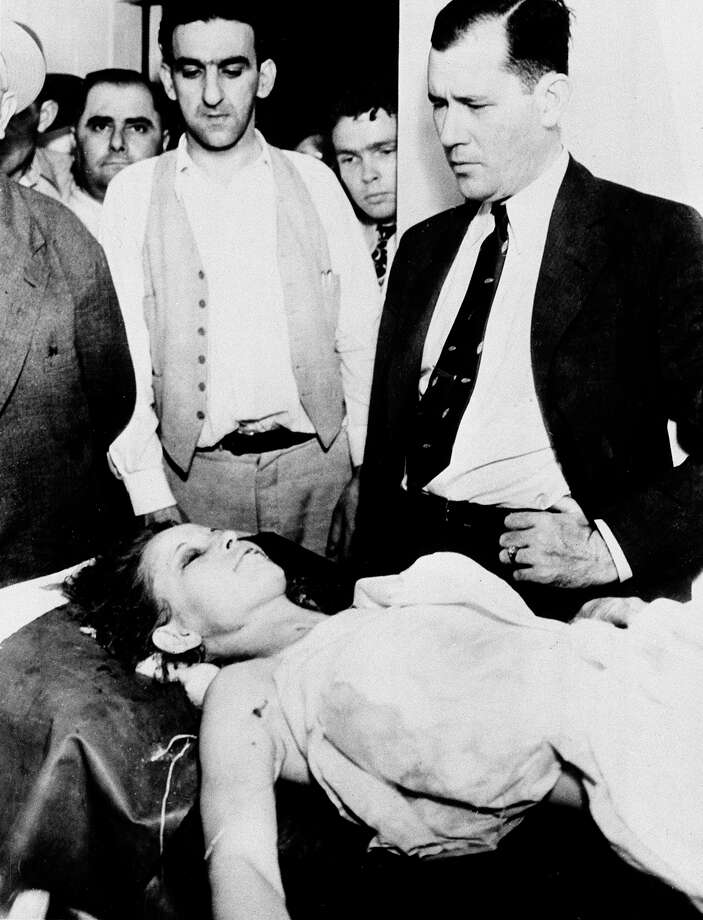 Bonnie Parker lays in the morgue at Arcadia, La., after being shot to death on a nearby country road with her bank robber partner Clyde Barrow on May 23, 1934. Looking on at right is Bill Decker, chief deputy of Dallas County, Texas. Photo: Associated Press