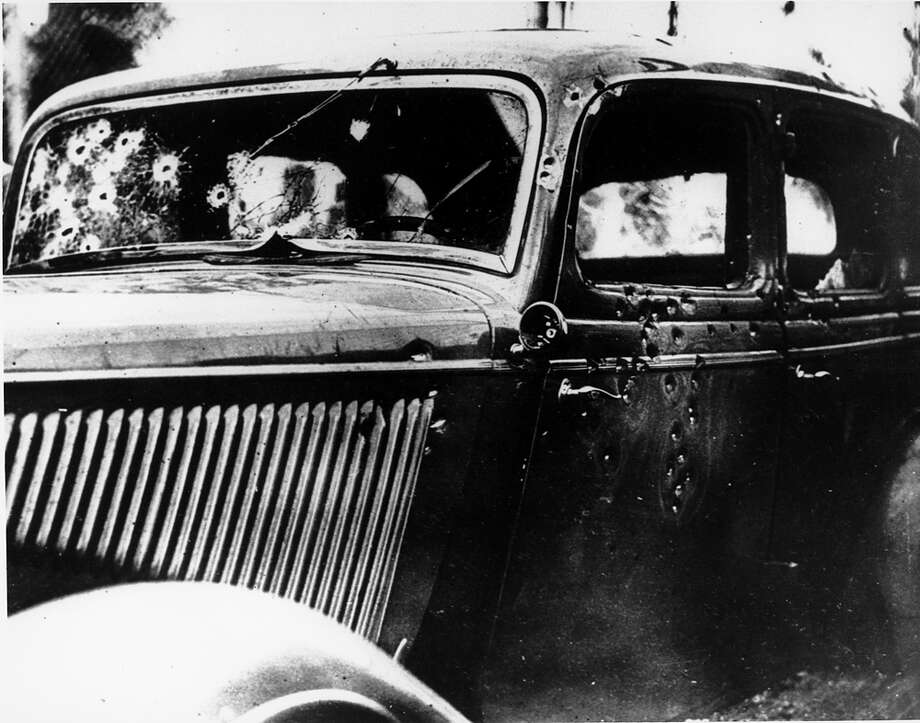 The bullet-riddled automobile in which bandits Clyde Barrow and Bonnie Parker were trapped, shot and killed on a Louisiana road is seen on May 24, 1934. Officers waited for the desperadoes near Arcadia, La., and pumped 167 bullets into the car. Photo: Associated Press