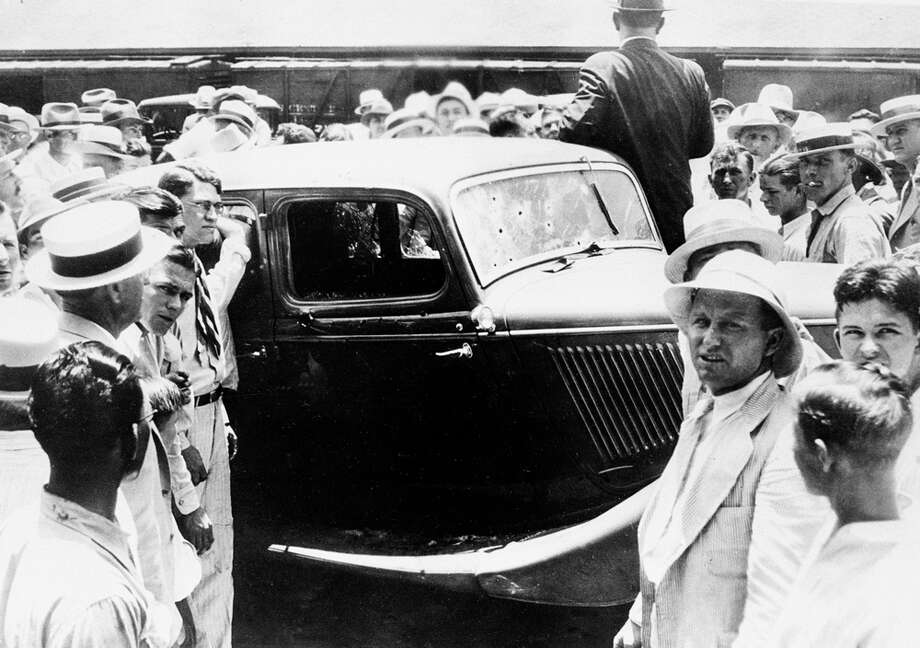 People crowd around the abandoned bullet-riddled 1934 Ford automobile in which Bonnie Parker and Clyde Barrows were killed by federal agents in Arcadia, La., May 23, 1934. Photo: Associated Press