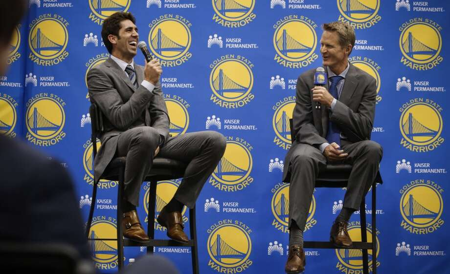 Team general manager Bob Myers, (left) and new the Golden State Warriors head coach Steve Kerr, share a laugh during a press conference at their training facility in Oakland, Calif., on Tuesday May 20, 2014. Photo: Michael Macor, The Chronicle
