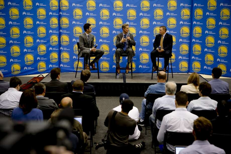 Team general manager Bob Myers, (left) joins new Golden State Warriors head coach Steve Kerr, (center) along with radio announcer Bob Fitzgerald during a press conference at their training facility in Oakland, Calif., on Tuesday May 20, 2014. Photo: Michael Macor, The Chronicle