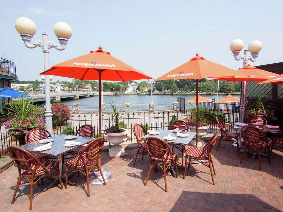 The patio at Arezzo in downtown Westport offers diners sweeping views of the Saugatuck River. Photo: Contributed Photo / Westport News
