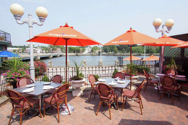 The patio at Arezzo in downtown Westport offers diners sweeping views of the Saugatuck River.