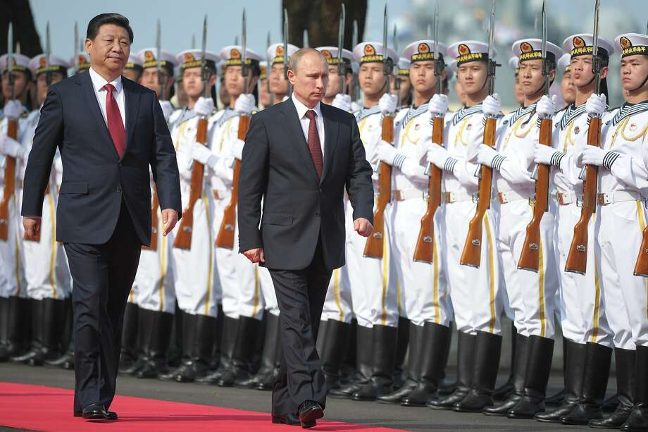 China's President Xi Jinping and Russian President Vladimir Putin are negotiating a natural-gas deal. Photo: Alexei Druzhinin, Associated Press