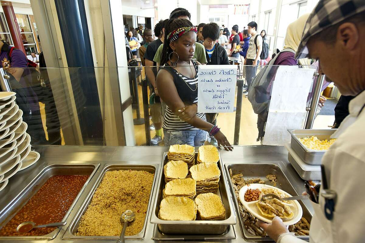 William Harris, kitchen manager at Berkeley High School, serves lunch on Monday, April 29, 2013, in Berkeley, Calif.