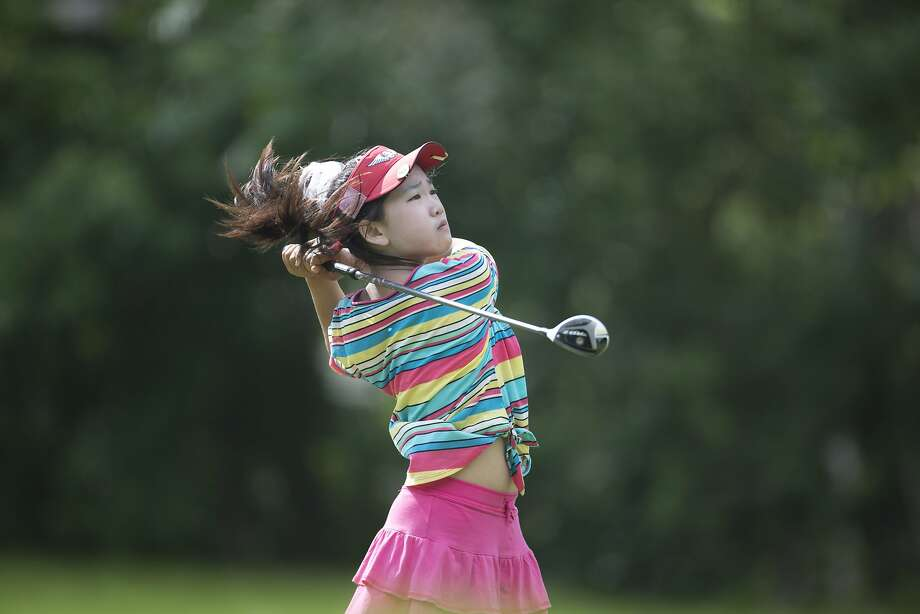 Lucy Li of Redwood Shores, shown competing last year at the Women's Amateur Public Links, has qualified for the U.S. Women's Open. Photo: Joel Kowsky, Associated Press
