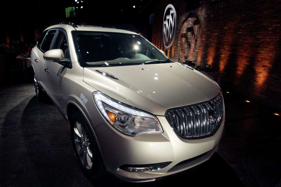 FILE - This April 3, 2012 file photo shows the 2013 Buick Enclave as it is unveiled at a news conference ahead of the New York International Car Show, in New York. General Motors on Tuesday, May 20, 2014 announced the recall of 2.4 million vehicles in the U.S., including the 2013 Enclave and other full-size crossovers from the 2009-2014 model years, as part of a broader effort to resolve outstanding safety issues more quickly. Photo: Mary Altaffer, AP / AP