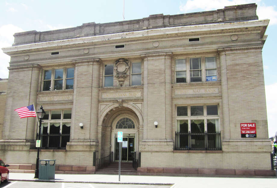 The more than a century-old bank building at the corner of Main and Bank streets in the New Milford village center is for sale. May 2014 Photo: Norm Cummings / The News-Times