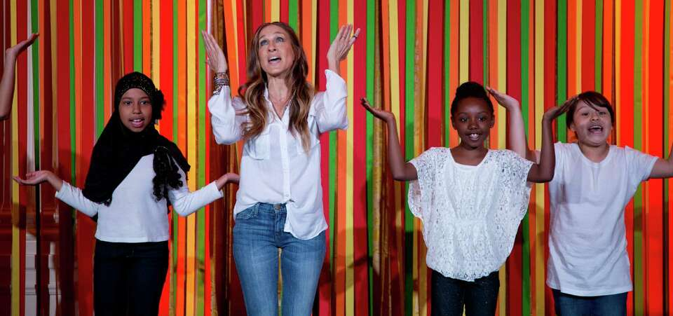 Actress Sarah Jessica Parker and students from the Martin Luther King, Jr., School in Portland, Ore.