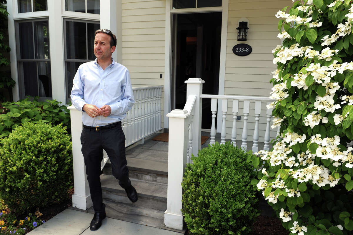 David Haffenreffer, Brokerage Manager with Houlihan Lawrence Real Estate, leads a tour of Milbank Court, a new condominium townhome neighborhood in Greenwich, Conn., May 20, 2014.