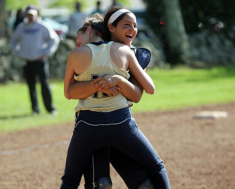 Kelly Conheeney shares a victory hug with teammate Ryan Correa after King School drubbed Masters School (Dobbs Ferry, NY) to win the FAA softball championship 22-2 in Stamford, Conn. on Tuesday May 20, 2014. Photo: J. Gregory Raymond / Stamford Advocate Freelance;  © J. Gregory Raymond