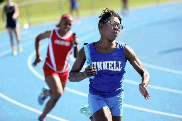 Bunnell High School's Roshedra Palmer makes her way down the last leg of the 4x100 meter race during Tuesday afternoon track meet at Bunnell High School. Bunnell would come in second during the heat. Photo: Mike Ross / Mike Ross Connecticut Post freelance -www.mikerossphoto.com