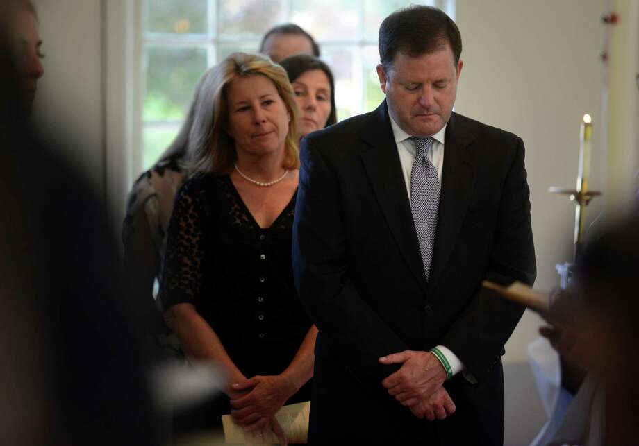 State Sen. John McKinney stands with his siblings Tuesday, May 20, 2014, to pay tribute to their mother, Lucie Cunningham McKinney, during a memorial service to celebrate her life at St. Timothy's Episcopal Church in Fairfield, Conn. Photo: Autumn Driscoll / Connecticut Post