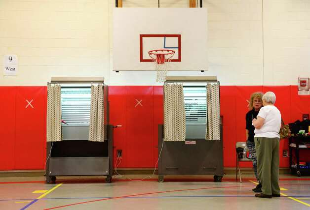 Voting booths stand empty at Roesslesville Elementary School for voters in the South Colonie school District Tuesday afternoon, May 20, 2014, in the school gym on California Ave. in Colonie, N.Y. (Will Waldron/Times Union) Photo: WW / 00026737A
