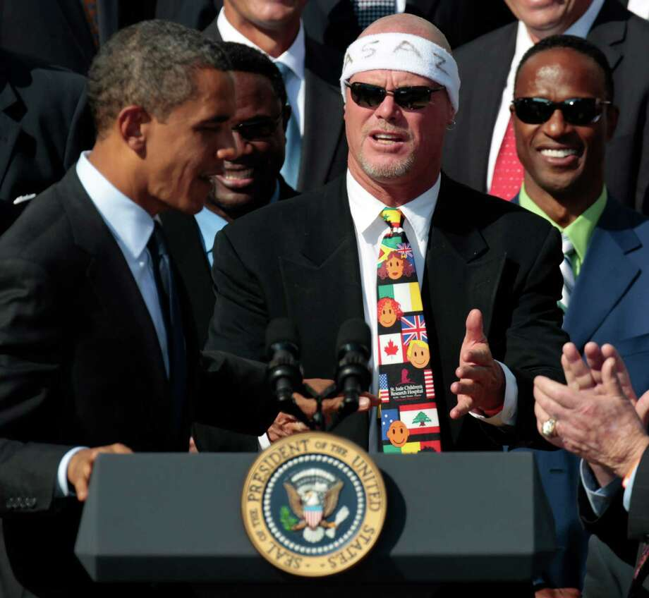 FILE - In this Oct. 7, 2011 file photo, President Barack Obama, left, looks towards quarterback Jim McMahon, wearing headband, as he honors the 1985 Super Bowl XX Champion Chicago Bears football team during a ceremony on the South Lawn of the White House in Washington. A group of retired NFL players says in a lawsuit that the league illegally supplied them with risky painkillers that numbed their injuries and led to medical complications. Attorney Steven Silverman says his firm filed the lawsuit Tuesday, May 20, 2014, in federal court in San Francisco. The eight named plaintiffs include Hall of Fame defensive end Richard Dent and quarterback Jim McMahon. (AP Photo/Pablo Martinez Monsivais, File) ORG XMIT: NY152 Photo: Pablo Martinez Monsivais / AP