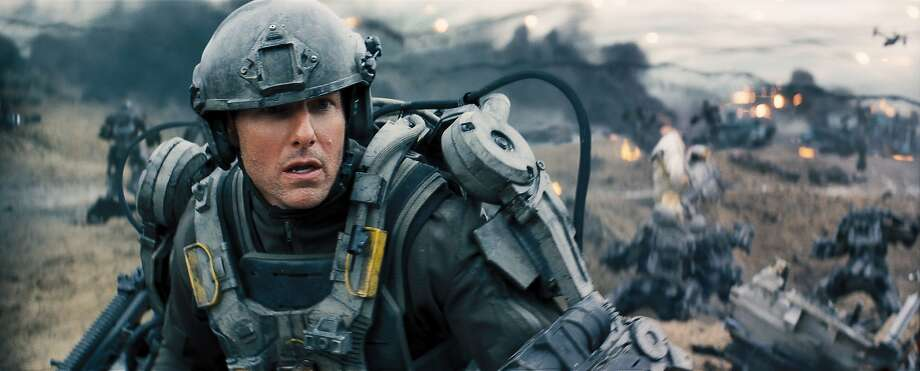 "Tom Cruise plays a soldier who gets to fight the same battle again and again in ""Edge of Tomorrow."" Photo: David James, Warner Bros."