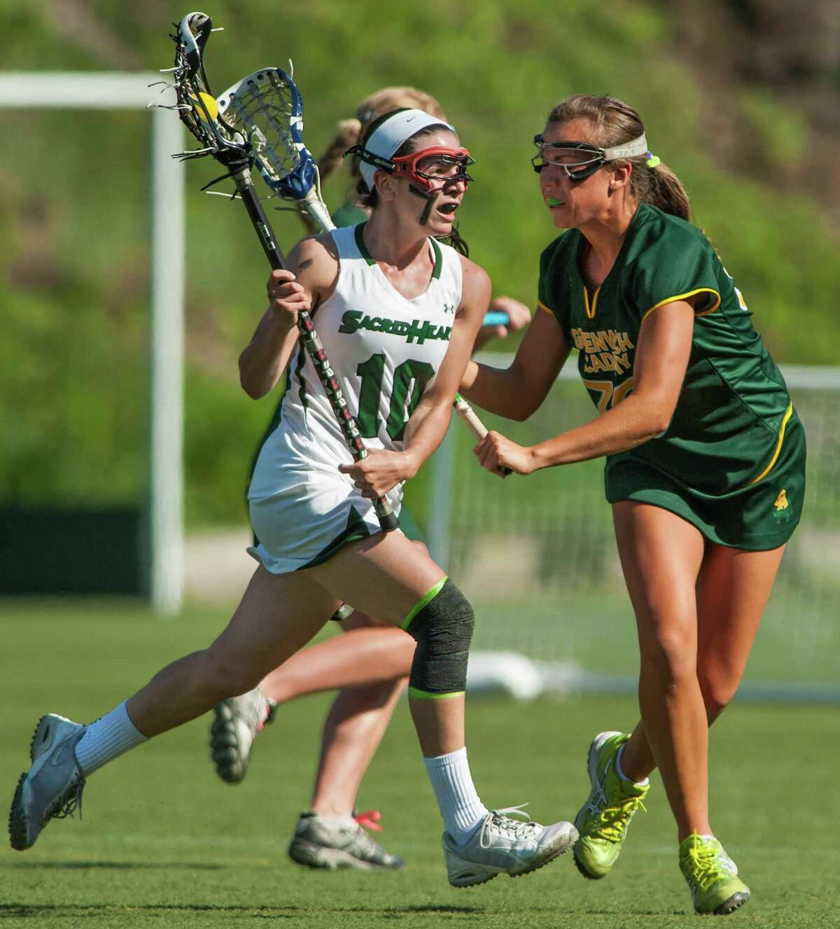 Convent of the Sacred Heart's Emma Novick tries to get by Greenwich Academy's Maggie Schmidt during the FAA girls lacrosse championship game played at Greenwich Academy, Greenwich, CT on Tuesday, May 20th, 2014.