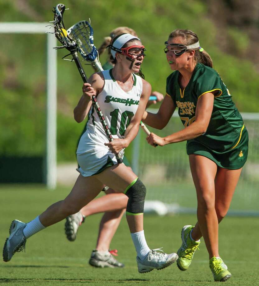Convent of the Sacred Heart's Emma Novick tries to get by Greenwich Academy's Maggie Schmidt during the FAA girls lacrosse championship game played at Greenwich Academy, Greenwich, CT on Tuesday, May 20th, 2014. Photo: Mark Conrad / Connecticut Post Freelance