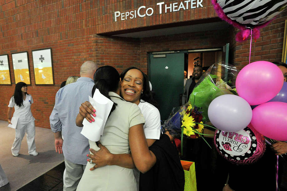 Graduate Wendy Headley, of Bridgeport, hugs Judy Gordon immediately following the Pinning Ceremony for graduating nurses at Norwalk Community College in Norwalk, Conn., on Tuesday, May 20, 2014. Photo: Jason Rearick / Stamford Advocate
