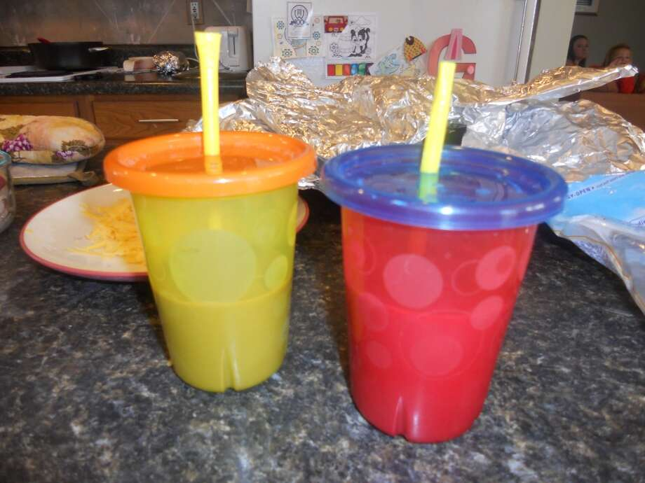 2: SERVE DRINKS IN LOW-MAINTENANCE CUPS. I swear by The First Years Take & Toss spill-proof straw cups.