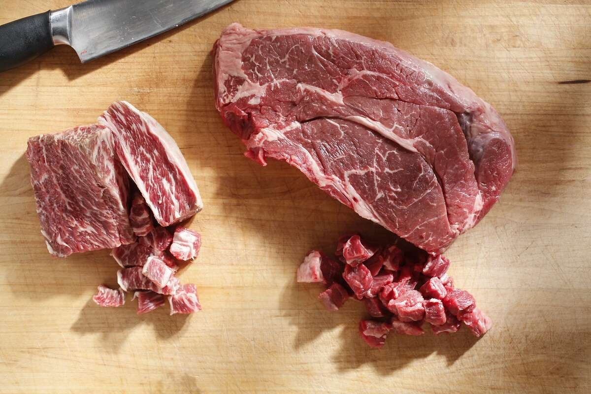 Beef chuck roast and short ribs on a cutting board as seen in San Francisco, California, on May 14, 2014. Food styled by Lynn Char Bennett.