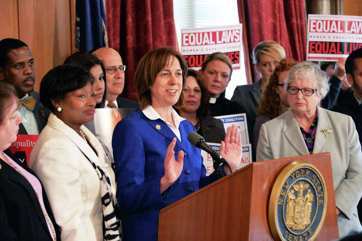 State Senator Cecilia Tkaczyk, center at podium, speaks at a news conference by Senate Democrats and advocates to press for action on the stalled Women's Equality Act Tuesday, May 20, 2014, at the Capitol in Albany, N.Y. (John Carl D'Annibale / Times Union)