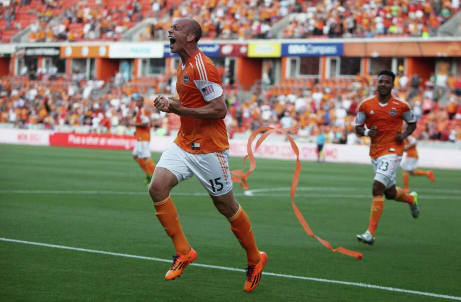 Mark Sherrod basks in the thrill of scoring in his first pro start, but he wasn't finished, as the May 11 game against Real Salt Lake included a second goal. Photo: Mayra Beltran, Staff / © 2014 Houston Chronicle