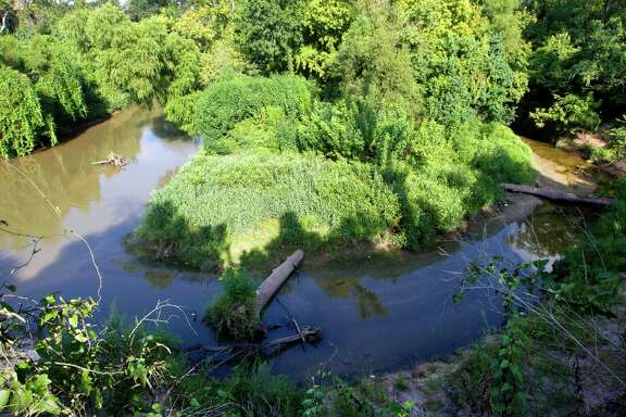 Environmental and conservation groups are alarmed by a plan to stabilize more than a mile of Buffalo Bayou, part of it flowing past the River Oaks Country Club and through the Hogg Bird Sancuary, above.
