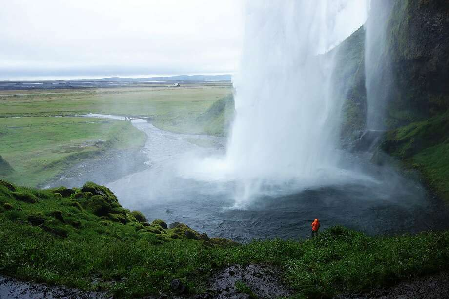 Nature rages powerfully at Seljalandsfoss in Iceland, a rugged country where English is widely spoken. The island weathers a volcano about every five years. Photo: Rick Steves, Special To The Chronicle